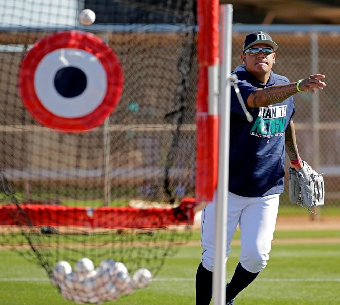 Mariners starting pitcher Felix Hernandez participates in a drill during spring training practice, Wednesday, Feb. 15, 2017, in Peoria, Ariz.