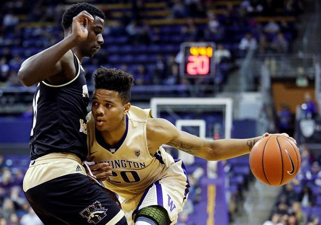In this Dec. 18, 2016, file photo, Washington guard Markelle Fultz, right, drives around Western Michigan guard Thomas Wilder, left, in the first half of an NCAA college basketball game in Seattle.