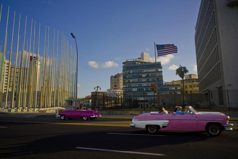 Tourists ride in classic American convertible cars past the United States embassy in Havana, last month.