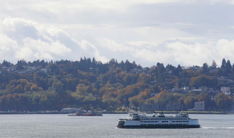 A Washington state ferry sails on Elliott Bay near West Seattle, Tuesday, Oct. 18, 2016, in Seattle