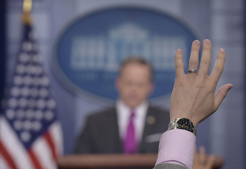 A reporter raises his hand to ask White House Press Secretary Sean Spicer a question at a daily briefing. The Trump administration has been highly critical of the media.