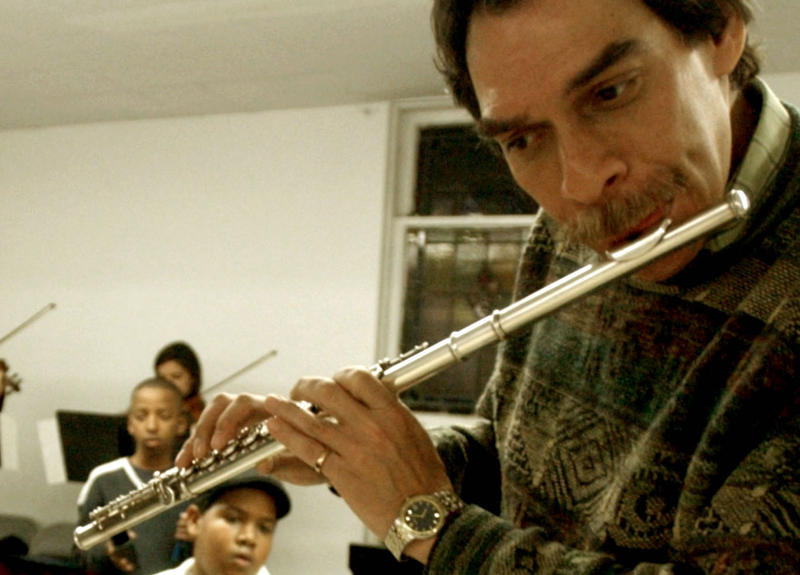 FILE: Flutist Dave Valentin and percussionist Camille Molina-Gaetan rehearse with the children of Opus 118 Harlem Center for Strings in New York, Monday December 1, 2003.