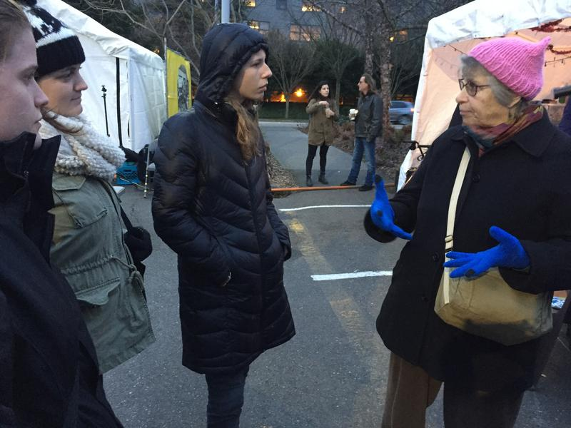 Lois Thetford, right, leads some of her students in an evening of outreach at Tent City 3 at the University of Washington.