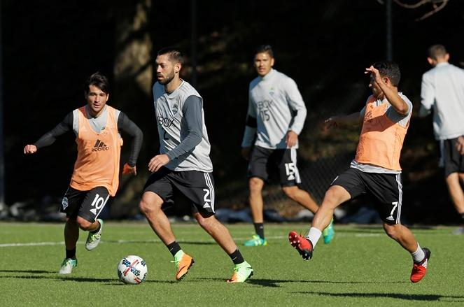Sounders forward Clint Dempsey (2) drives the ball between forward Nicolas Lodeiro, left, and midfielder Cristian Roldan, right, Monday, Feb. 13, 2017, during training in Tukwila.