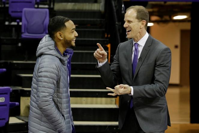 Mike Hopkins, Washington's new head basketball coach, talks with guard David Crisp, Wednesday, March 22, 2017, in Seattle. Hopkins, a longtime Syracuse assistant coach, replaces Lorenzo Romar.