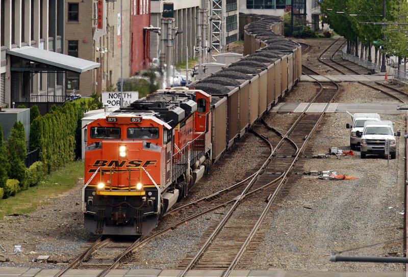 A train hauling coal to British Columbia heads north out of downtown Seattle Tuesday afternoon, May 29, 2012.