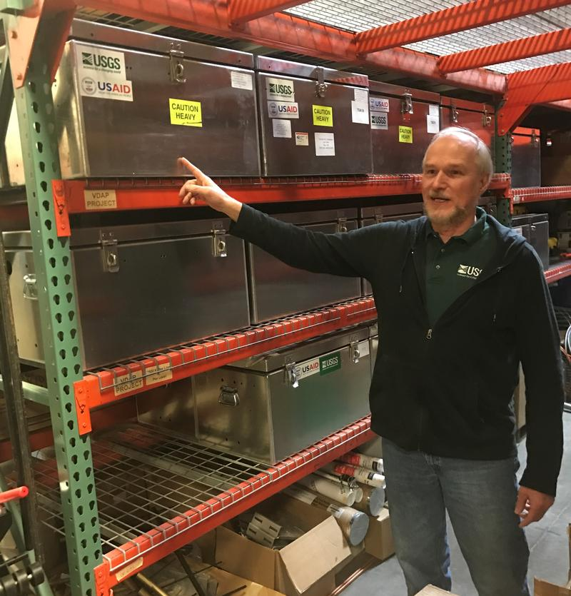 John Pallister, of the Volcano Disaster Assistance Program, showing one of the boxes at the Cascades Volcano Observatory that can be sent out to aid in disaster prevention.