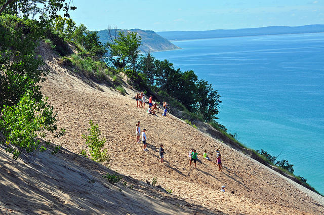 Visitors sit on the dunes at Sleeping Bear National Lakeshore in Michigan, some 450 feet above Lake Michigan.