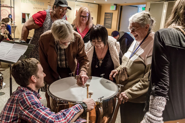 Seattle Symphony musician Michael Werner demonstrates the timpani to Path With Art students