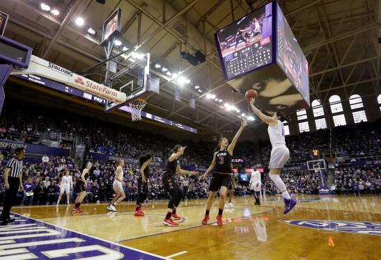 Washington's Kelsey Plum, right, shoots over Utah's Malia Nawahine (3) to score her first points in UW's final regular season game Saturday, Feb. 25, 2017, in Seattle. Plum scored 57 points and set a new NCAA career scoring record.