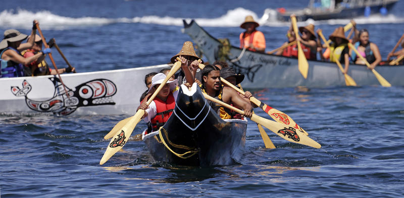 A canoe from the Puyallup Tribe is paddled toward a landing during an annual journey Wednesday, July 27, 2016, in Seattle.