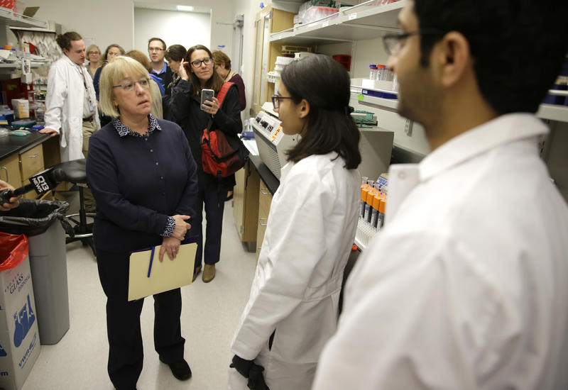 U.S. Sen. Patty Murray, D-Wash., left, talks with researchers Fahd Al Qureshah, right, and Nicole Arroyo, second from right, as she tours an immunology research lab at the University of Washington's UW Medicine South Lake Union Campus Wednesday, April 1