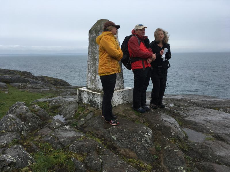 One of the most popular hikes in the momument lands is to the Obelisk at Point Colville on Lopez Island. Community organizers Tom and Sally Reeve led Bellamy Pailthorp to the top in this photo from early April 2017.