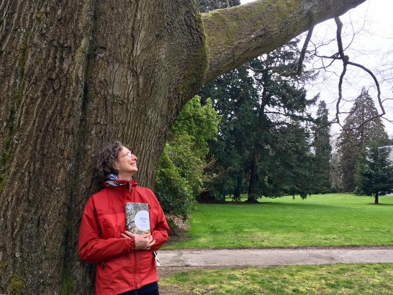 "Seattle Times Writer Lynda V. Mapes stands beneath ""the Queen,"" in Seattle's Vounteer Park. She says its similar to the oak portrayed in her new book, Witness Tree."