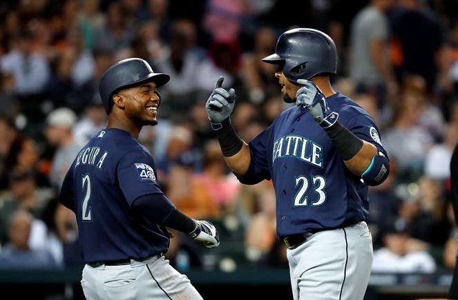 Nelson Cruz celebrates his two-run home run against the Detroit Tigers with Jean Segura in the sixth inning of a game in Detroit, Wednesday, April 26, 2017.
