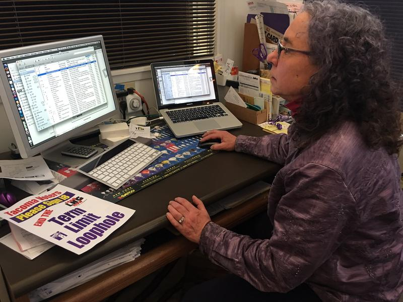 Sherry Bockwinkel works on literature for an upcoming petition drive, inside her office at Tacoma Lamp Repair. She was an early adopter of paid signature gathering in Washington state.