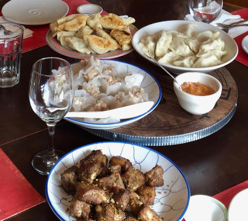 Clockwise from top: Potstickers, boiled jao-tse, shrimp oil/cashew mayo, cumin ribs, crystal shrimp
