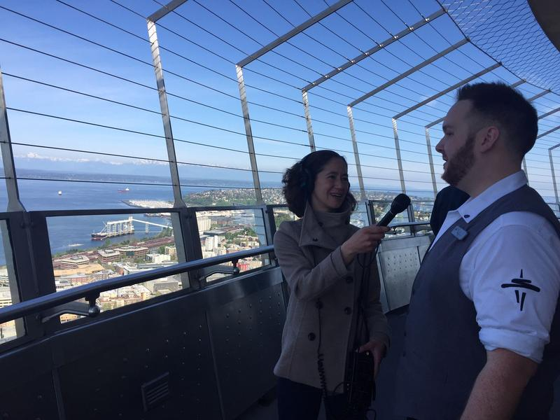 Sound Effect host Jennifer Wing with Space Needle elevator operator B.J. Listman on the Space Needle observation deck.