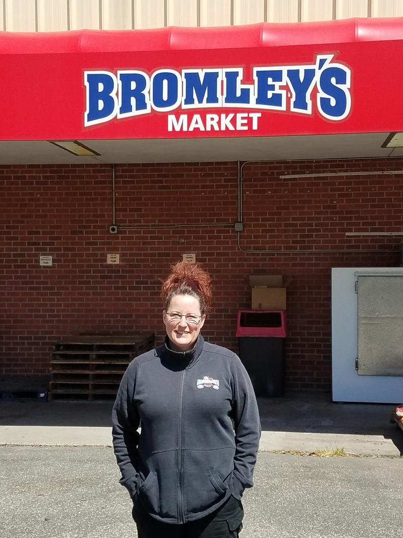 Catherine DeBruin stands outside her father, Bob Bromley's grocery story in Sumas, Wash. near the U.S.-Canada border.