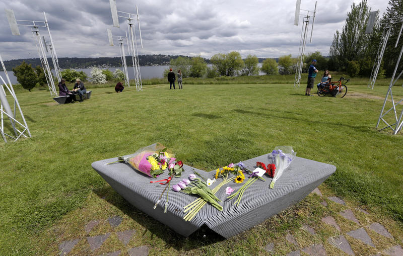 Flowers sit on a bench at the Sound Garden sculpture, for which the band Soundgarden was named, in Seattle's Magnuson Park in tribute to Chris Cornell, Thursday, May 18, 2017.