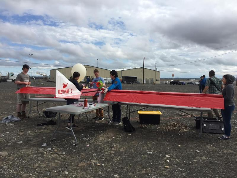 University of Washington students make their final preparations at the Grant County International Airport