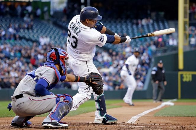 Nelson Cruz drives in a run as he grounds out in the first inning of a game against the Texas Rangers, Saturday, May 6, 2017, at Safeco Field.
