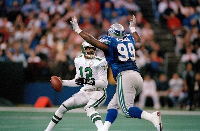 Quarterback Randell Cunningham (12) of the Philadelphia Eagles is unable to avoid the rush of Cortez Kennedy (99) of the Seattle Seahawks during the fourth quarter of NFL game in Seattle, Dec. 13, 1992.