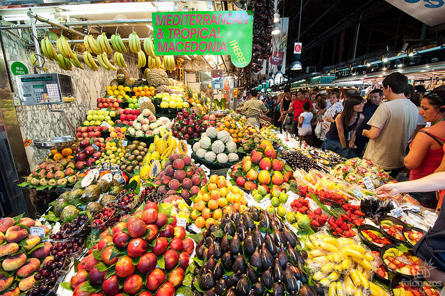 Shoppers browse a market in Barcelona, Spain.