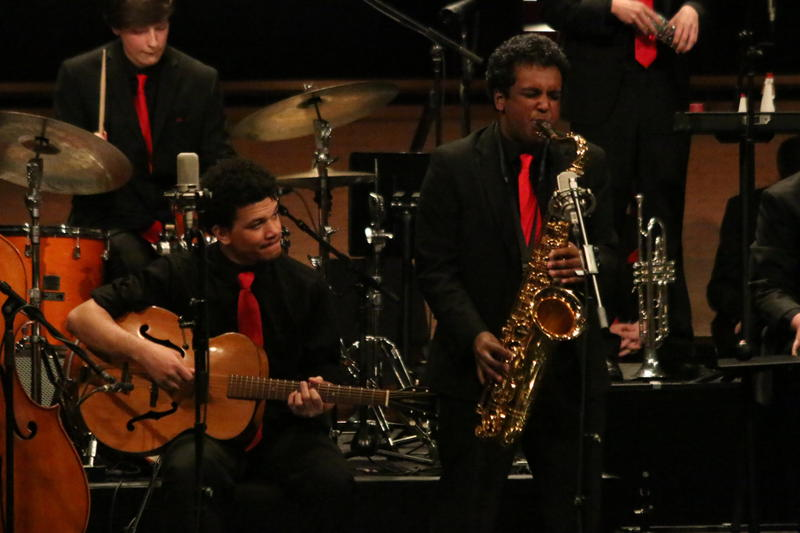 Damon Dahl (guitar), Kieran Farris (drums) and Dylan Raja (tenor) play during the Mountlake Terrace performance at Essentially Ellington