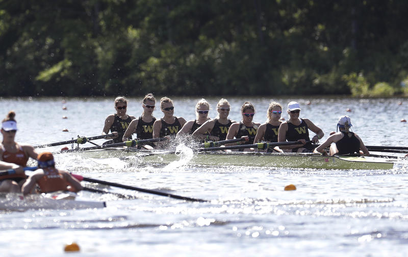 The Washington women's varsity second eight team, right, competes against Texas, left, during a semifinal race at the NCAA women's college rowing championships, Saturday, May 27, 2017, at Mercer County Park in West Windsor, N.J.