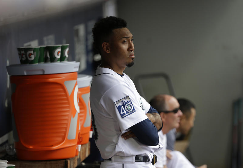 Mariners pitcher Edwin Diaz stands in the dugout in the ninth inning in Seattle. Diaz was charged with the loss and a blown save as the Phillies beat the Mariners 5-4.