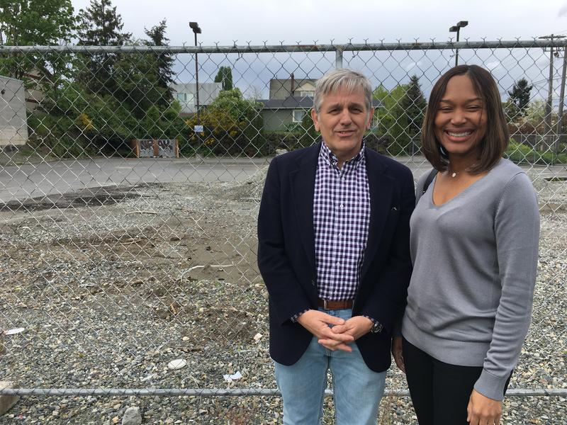 Capitol Hill Housing CEO Christopher Persons and Centerstone CEO Andrea Caupain pose in front of the site of the old Liberty Bank in May before the new project's groundbreaking Monday.