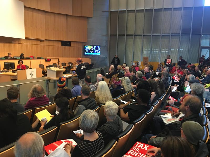 Residents speak at a recent public hearing about Seattle's income tax proposal set to head to a City Council vote in July.