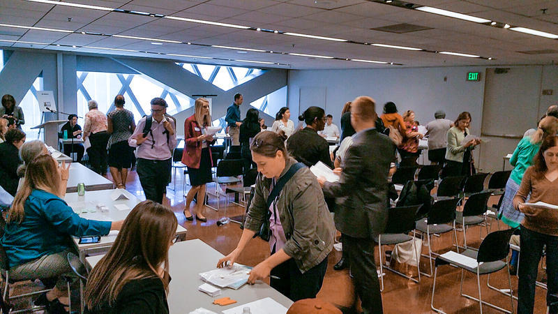 "Members of the Public attending a ""re-entry simulation"" at Seattle Public Library to learn about the challenges of getting back on your feet after incarceration."