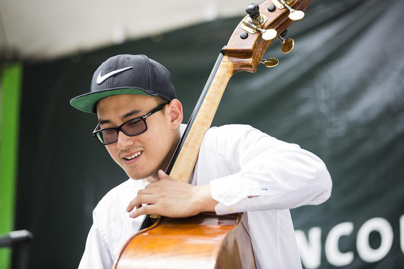 Vancouver native John Lee played alongside Ariel Pocock at the Roboson Street Stage during the TD Vancouver International Jazz Festival.