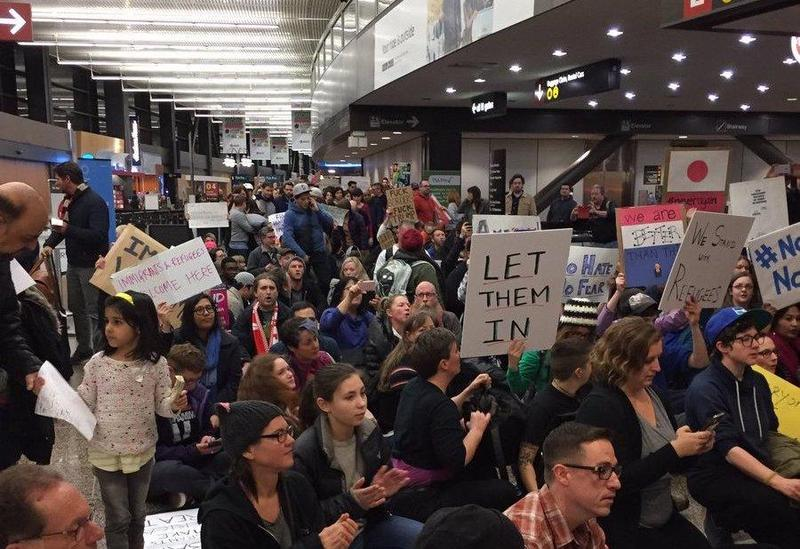 Protesters gather near Baggage Claim 1 at Sea-Tac Airport in January 2017
