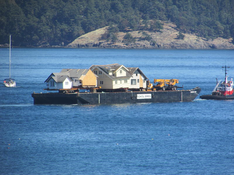 The houses arrive by barge in Friday Harbor from Victoria, British Columbia.