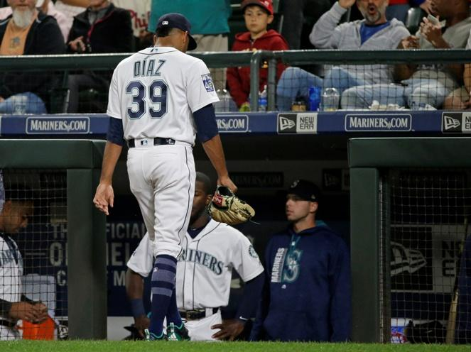 Mariners pitcher Edwin Diaz walks to the dugout after he was pulled in the ninth against the Philadelphia Phillies, Tuesday, June 27, 2017, in Seattle. Diaz faced six batters and gave up four runs, none of them earned. The Phillies beat the Mariners 8-2.
