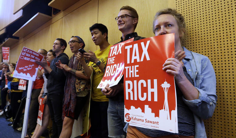 Supporters of a high earner income tax packed Seattle City Council chambers on July 10, 2017 as the Council unanimously passed the measure.