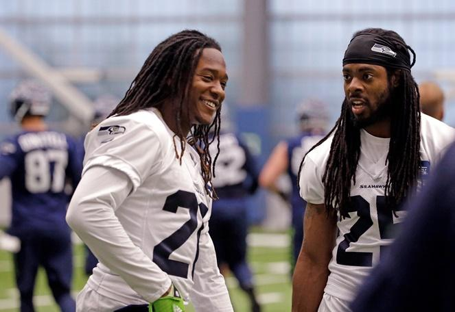 The one to watch: Seattle Seahawks' Shaquill Griffin and Richard Sherman talk between drills during NFL football practice Thursday, June 15, 2017, in Renton.