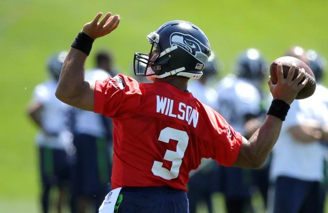 Seahawks quarterback Russell Wilson passes during NFL football practice, Friday, June 2, 2017, in Renton.