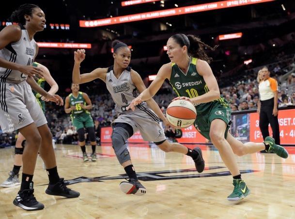 Seattle Storm guard Sue Bird drives around San Antonio Stars guard Moriah Jefferson (4) during a WNBA basketball game, Tuesday, June 6, 2017, in San Antonio. Seattle won 85-76.