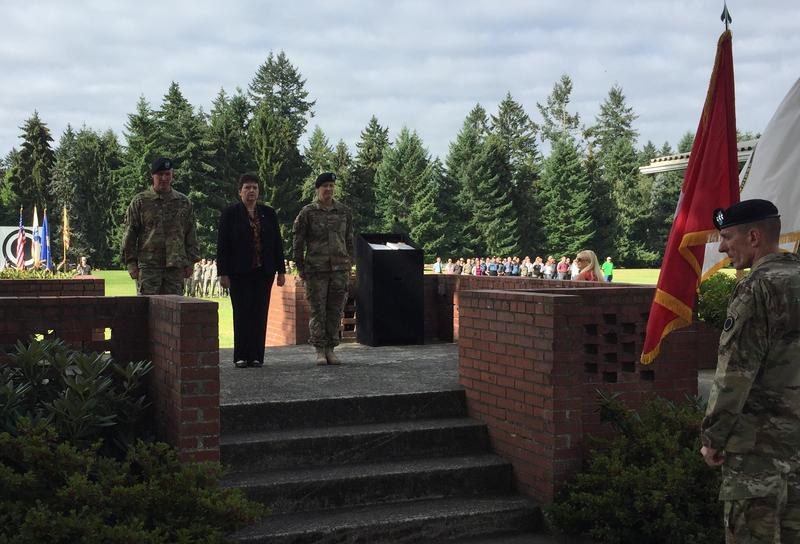 A July 28, 2017, ceremony marked the start of Col. Nicole Lucas's tenure as garrison commander at Joint Base Lewis-McChord. From left: Col. Dan Morgan;  Brenda Lee McCullough; and Lucas