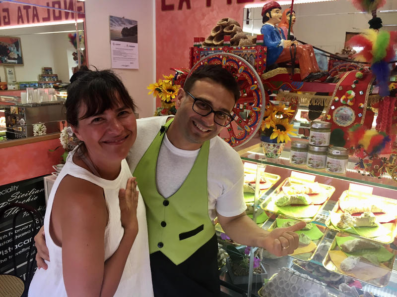 Onofrio, with Earthbound Expeditions co-founder Danna Brumley, at his shop La Pignolata Guinness, in Taormina, Sicily.
