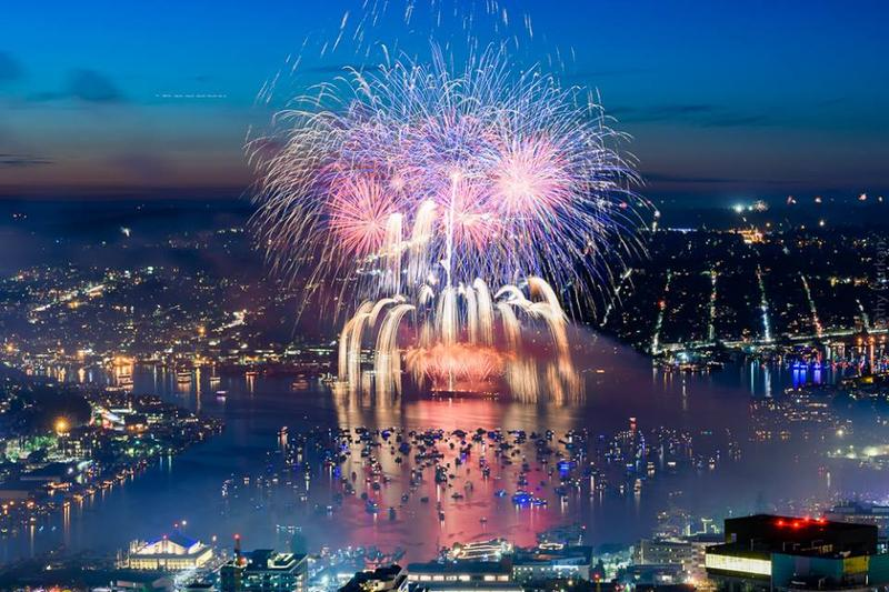 Seattle's Space Needle is obscured by fireworks during the 2017 Independence Day show above Lake Union.