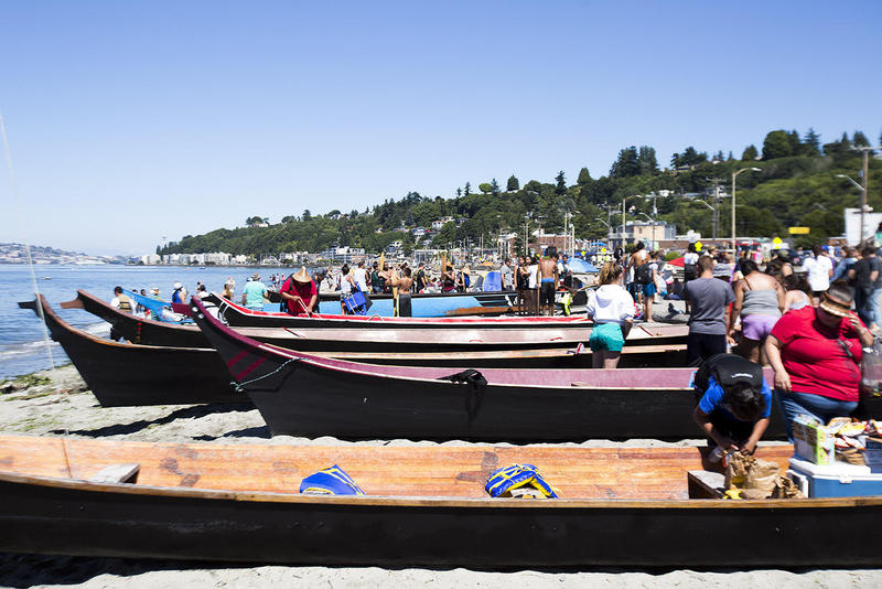 Tribal members participating in an annual canoe journey park the vessels at Alki Beach Park before heading back out on the water to Suquamish, Wash.