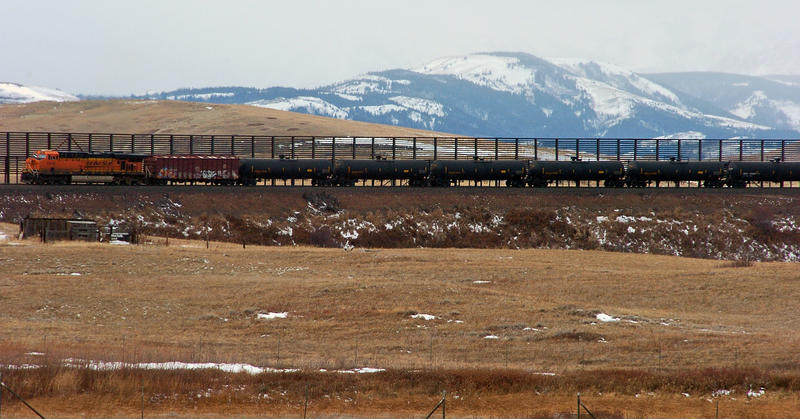 In this Nov. 7, 2013 file photo, a train hauls oil into Glacier National Park near the Badger-Two Medicine National Forest in northwest Montana. Companies are proposing to build the nation's largest oil-by-rail marine terminal in southwest Washington.