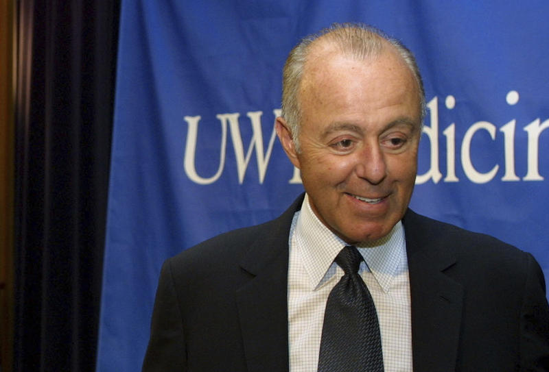 In this April 24, 2003, file photo, Jeff Brotman, Chairman of Costco Wholesale Corporation, speaks during a news conference at the University of Washington in Seattle.