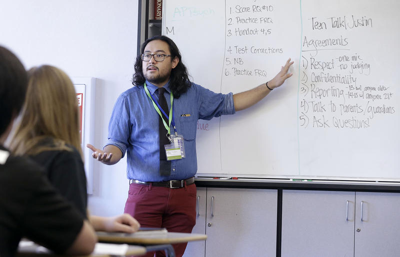 Justin Balido, peer health coordinator and senior health educator with Health Connected, speaks to a ninth-grade class at a California high school in 2015.