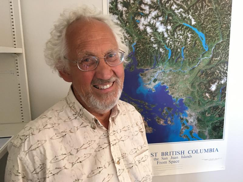 Bert Webber in front of a map of the Salish Sea